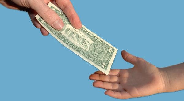 allowances-handing-dollar