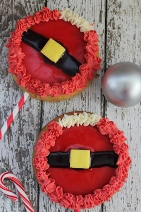Fun Christmas cookies to make with the kids - Santa Suit Cookie Pops! These would be perfect for a classroom Christmas party edible craft too!